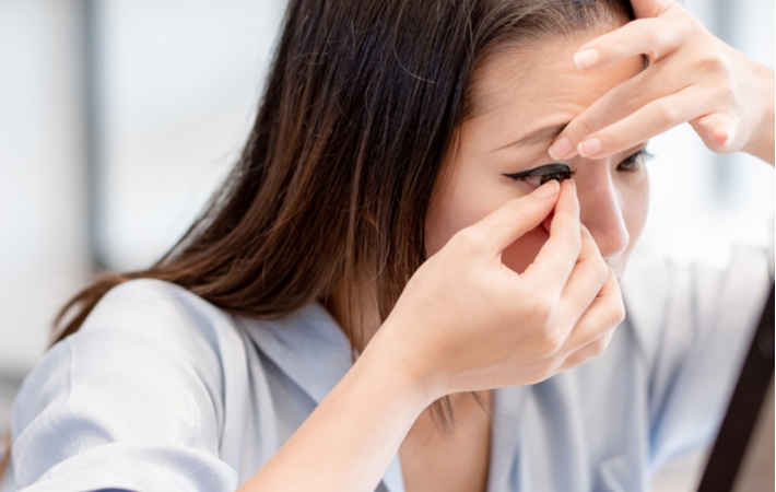 A woman putting in a set of contact lenses